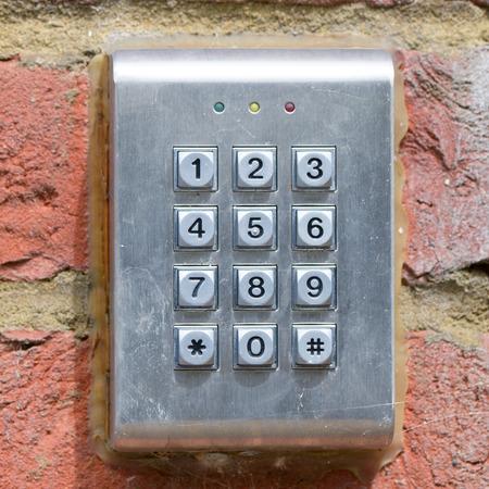 10 key: Keypad on wall to access property Stock Photo