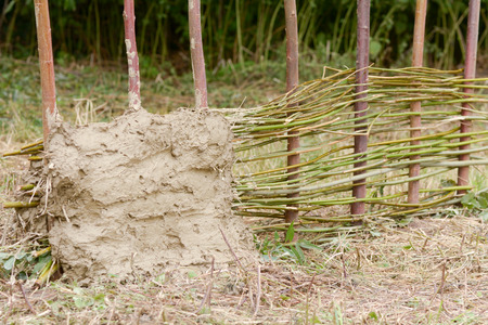 daub: Wattle and daub traditional building method