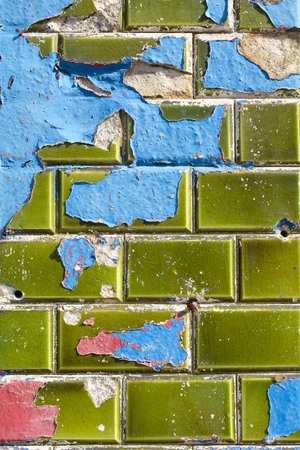���wall tiles���: Green wall tiles with peeling red and blue paint