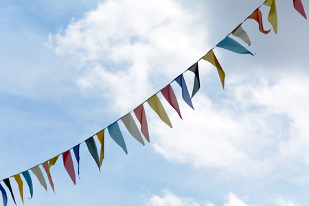 fluttering: Carnival bunting flags fluttering in the wind Stock Photo