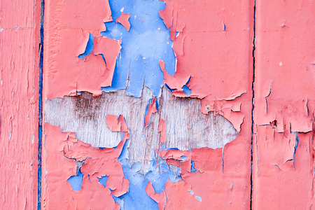 flaked: Red and blue flaked paint on wooden door