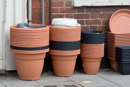 flower pots: Stacks of plastic flower pots outside shop Stock Photo