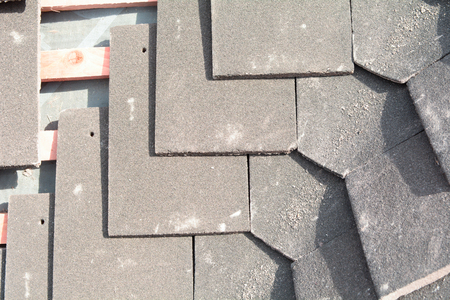 fixed line: Corner or gulley roof tiles being fitted