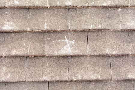 batten: X mark on roof tiles to show fixing point to roof batten