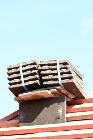 roof tiles: Stack of roof tiles on roof ready to fit