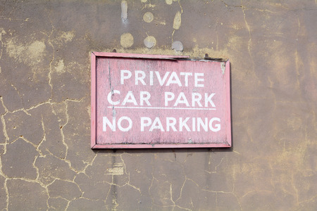 no parking sign: Private Car Park - No parking sign on wall Stock Photo