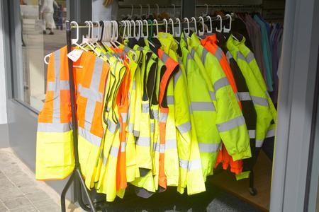 visibility: Hi-visibility jackets for sale on rack outside shop