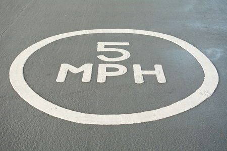 mph: 5 MPH speed limit sign on ground in car park