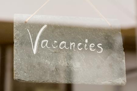 holidays vacancy: Vacancies sign in hotel window