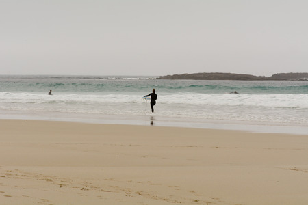 sennen: Sennen Cove, Cornwall, England October,24 2014: A surfer leaving the sea after morning surfing Editorial