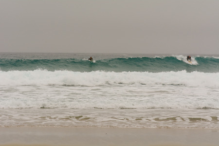 sennen: Sennen Cove, Cornwall, England October,24 2014: A surfer catching a wave