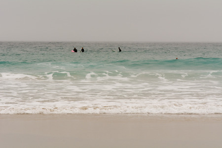 sennen: Sennen Cove, Cornwall, England October,24 2014: Surfers sat on boards waiting for the right wave