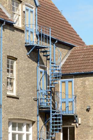 escape: Spiral staircase fire escape outside property