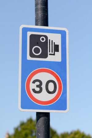 camera: 30 mph speed limit and speed cameras present sign