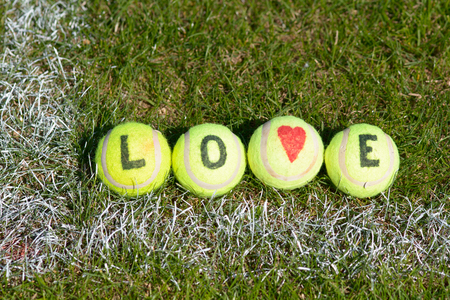 responding: Tennis balls abstract word love and love heart