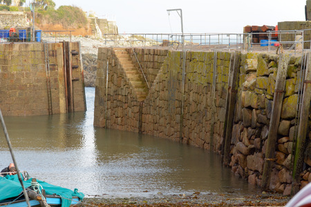 mousehole: Mousehole harbour wall, Cornwall, England Stock Photo