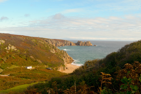 headland: Logan Rock headland and Porthcurno beach, Cornwall, England