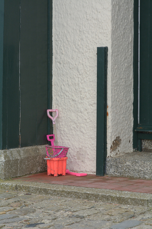 bucket and spade: Bucket and spade set outside house Stock Photo