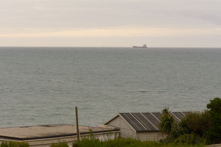 english channel: Large container ship on horizon in English Channel Stock Photo
