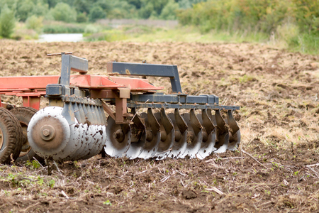 ploughing: Farmer ploughing fields with tractor