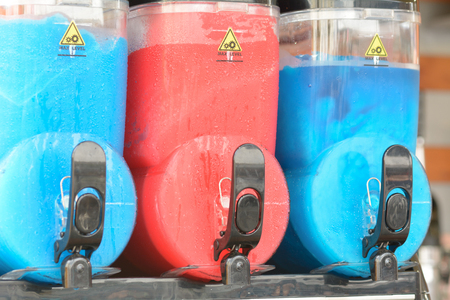 slush: Blue and red slush puppy ice drink containers Stock Photo