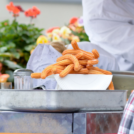 batters: Churros on plate at food stall