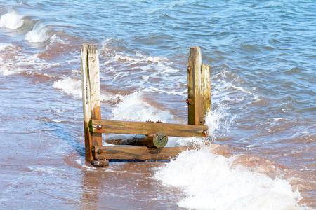 groyne: Wooden groyne on beach Stock Photo