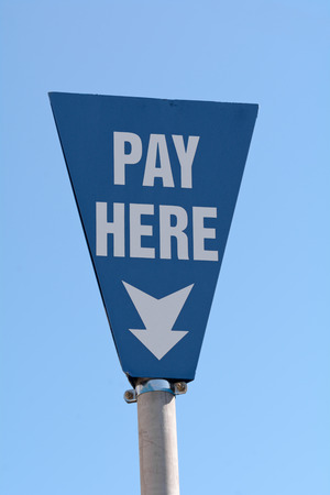 metre: Pay Here sign in car park Stock Photo