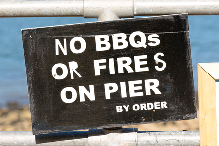 no fires: No BBQs or Fires on Pier sign Stock Photo