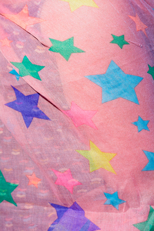 womans clothing: Womans pink scarf with colourful stars