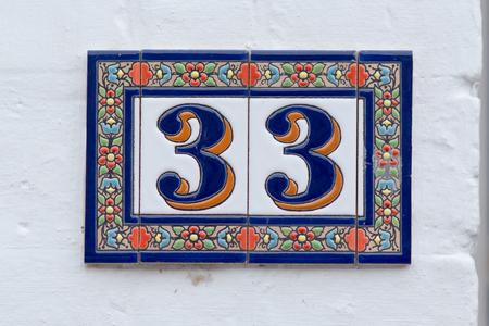 inform information: House number 33 sign