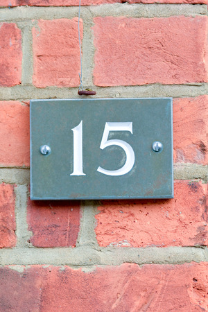 number 15: House number 15 sign