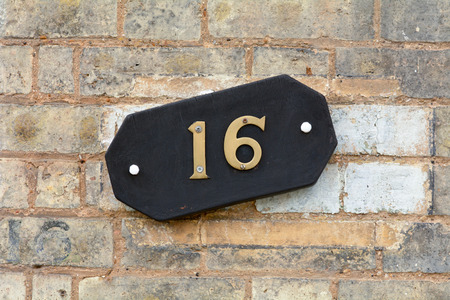 16: House Number 16 sign