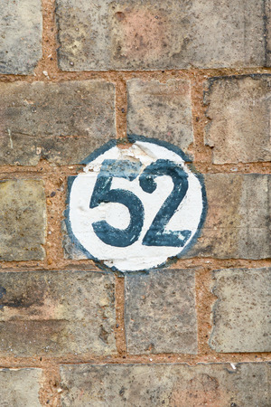 inform information: House Number 52 sign Stock Photo