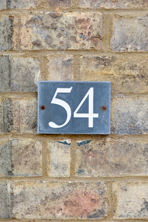54: House Number 54 sign Stock Photo