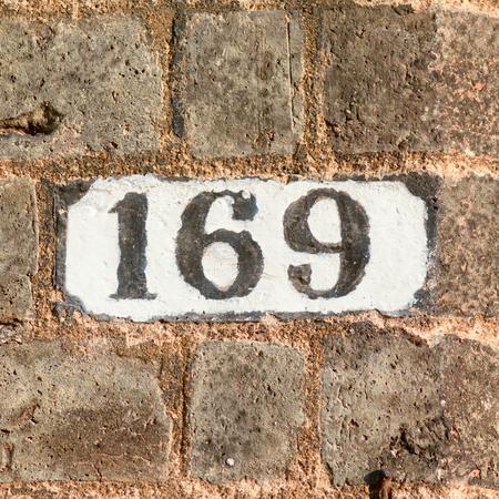 inform information: House number 169 sign