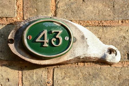 inform information: House number 43 sign