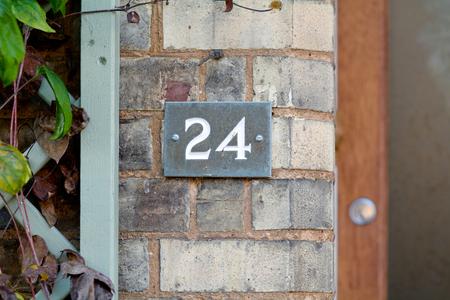 inform information: House number 24 sign