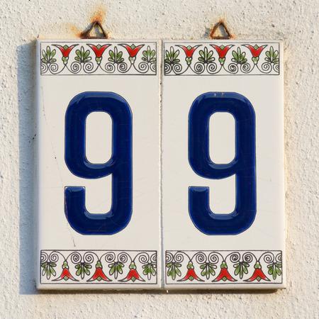 inform information: House number 999 tiles sign