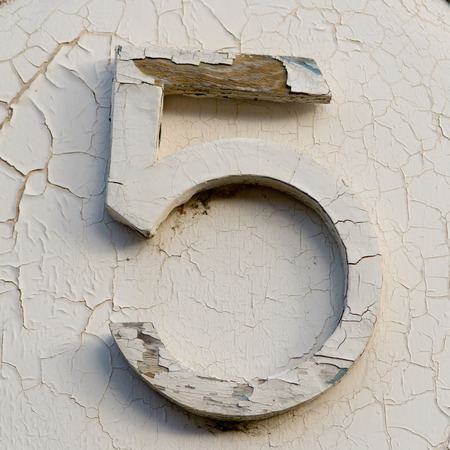 old house: House number 5 sign