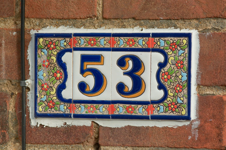 green house: House number 53 sign