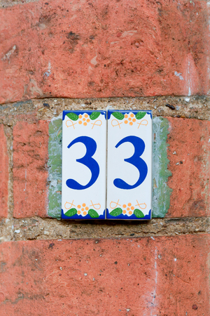white house: House number 33 sign