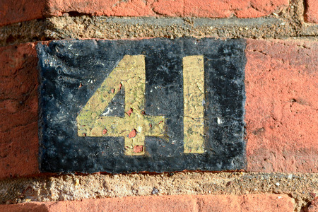 house walls: House number 41 sign