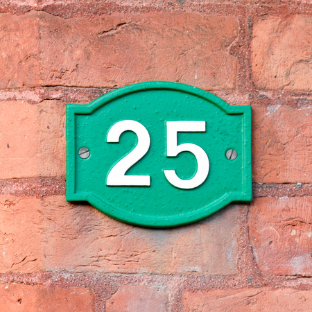 green house: House number 25 sign Stock Photo