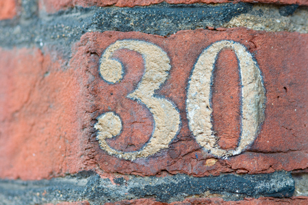 the 30: House number 30 sign Stock Photo