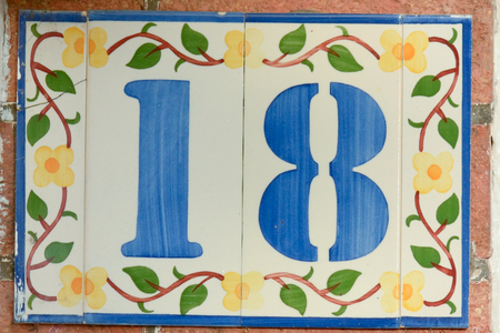 18: House number 18 sign Stock Photo