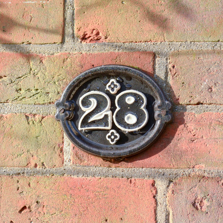 28: House number 28 sign