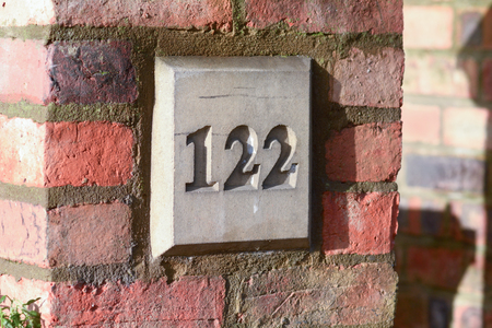 inform information: House number 122 sign Stock Photo