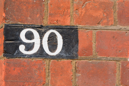 white house: House number 90 painted sign