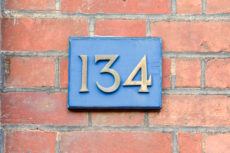 white house: House number 134 sign